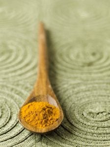 turmeric-in-wooden-spoon